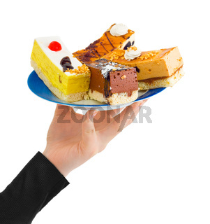 Hand giving plate with cakes