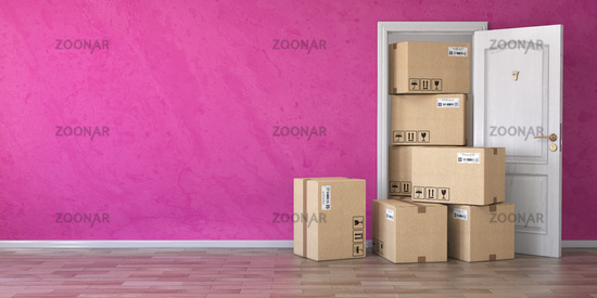 Delivery service or moving concept.. Cardboard boxes front of entrance open door.