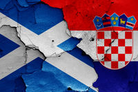flags of Scotland and Croatia painted on cracked wall