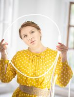 Beauty Concept. Beautiful Middle-aged Woman Posing with Diode Tape