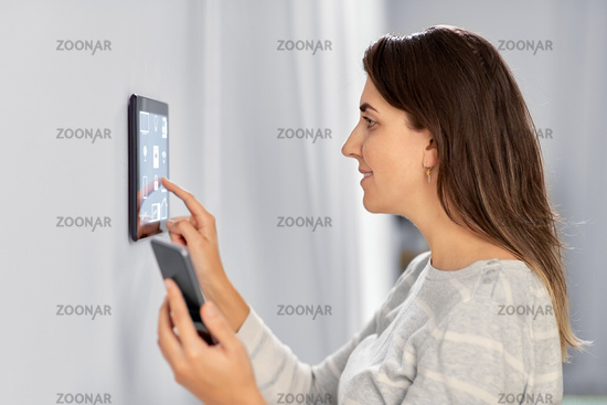 woman using tablet computer and smartphone