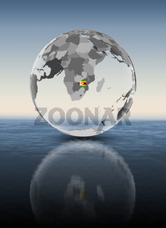 Zimbabwe on translucent globe above water