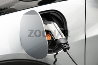 EV or Electric car at charging station plugged in