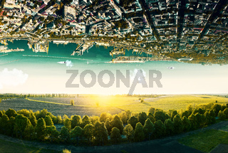Natural landscape with unreal upside down sityscape.