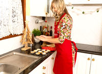 Woman making home made mince pies at Christmas time