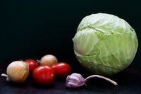 Raw vegetables on dark background