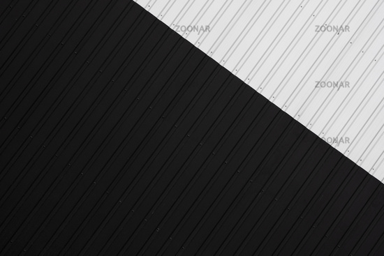 Black and white Corrugated metal sheet texture surface of the wall. Galvanize steel background.