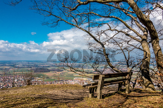 Lonely bench on a hill with wide view down