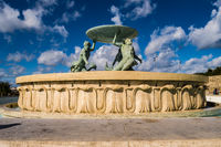 The famous Triton fountain, three bronze Tritons holding up a huge basin, in front of the City Gate in Valletta,