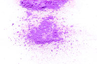 Pile of violet powder isolated on white background.