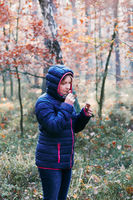 Woman smelling a mushroom picked in forest