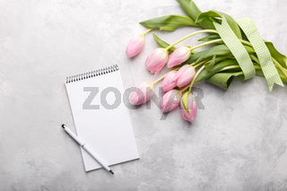 Pink tulips and notepad