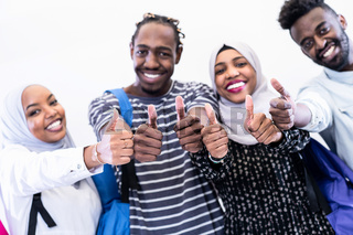 african students group showing ok thumbs up