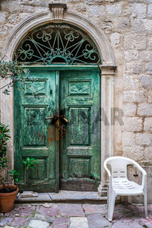 Old door and plastic chair