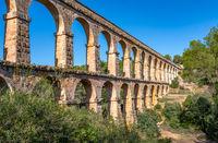Ancient roman aqueduct Ponte del Diable or Devil's Bridge in Tarragona, Spain.