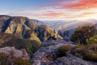 Female hiker admiring mountain wilderness beauty