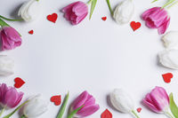 Frame of tulips and hearts