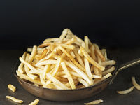 pan of rustic golden french fries