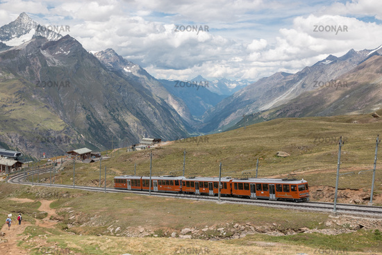 Gornergrat train with tourist is going to Matterhorn mountain
