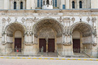 close up view of the three doors of the historic Saint Michel Church in the old city center of Dijon in Burgundy