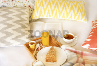 Cozy breakfast in bed with tea