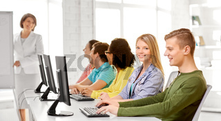 happy high school students in computer class