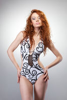 portrait of red hair woman in swimsuit