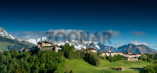 Gruyeres, VD / Switzerland - 31 May 2019: panorama view the historic castle and village of Gruyeres with mountain landscape