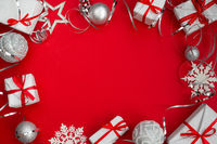 Many Christmas gifts on red