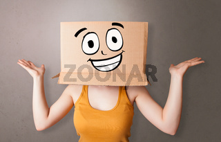 Young girl with happy cardboard box face