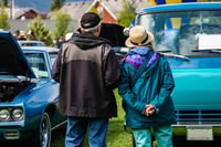 people during the outdoor antique car show