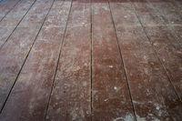 old wooden board floor / floorboards in  apartment room before refurbishment