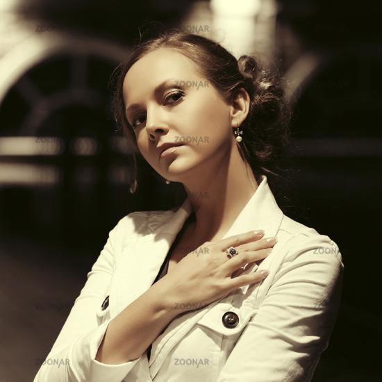 Sad beautiful fashion woman walking in night city street