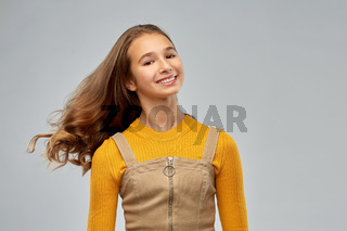 young teenage girl with waving long hair