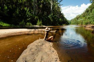Woman relaxing along the shallows of the Grose River