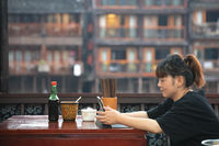 Chinese woman sitting in a restaurant