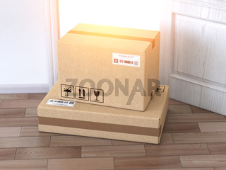 Delivery service concept.. Cardboard box front of entrance open door.