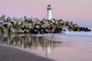Twilight over Breakwater (Walton) Lighthouse as seen from Seabright Beach.