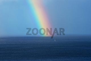 Beautiful rainbow on the ocean horizon