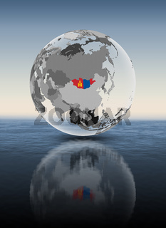 Mongolia on translucent globe above water