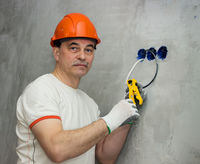 Electrician busy repairing wiring in apartment