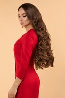 Glamorous lady in red dress with make up and wavy hair.