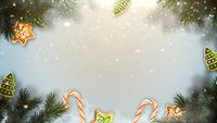 Closeup Christmas green tree branches and toys on snow background