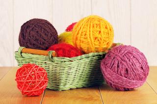 Different Yarn Balls In Wooden Basket
