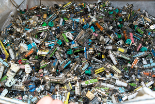 Various components from dismantled electronic equipment waiting to be recycled on a recycling plant site. Sorted electronic garbage.