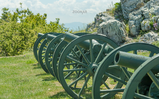 Old metal cannon. Shipka, Gabrovo, Bulgaria. The Shipka Memorial is situated on the peak of Shipka in the Balkan Mountains near Kazanlak, Bulgaria. Old metal cannons against blue sky with clouds.