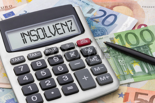 Calculator with euro bills - Insolvency - Insolvenz (German)