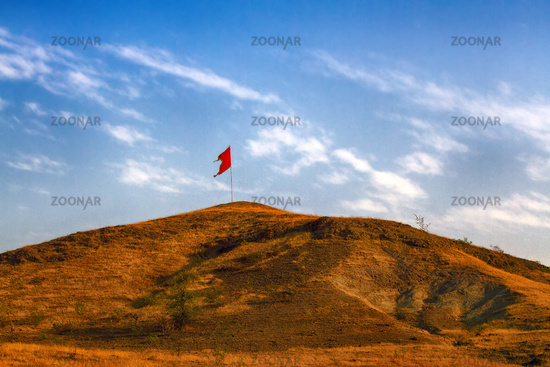 Red Communist flag on the mountain. In India