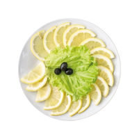 Sliced lemon on a plate, isolated on white background. Top view.