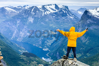 Tourist man on Dalsnibba viewpoint Norway